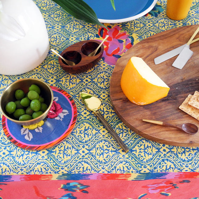 Wood and brass small spoon on Lisa Corti tablecloth creates a Colorful Home Decor and colorful tablescapes - Collyer's Mansion