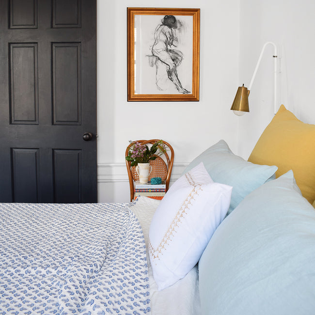Linge Particulier Yellow Gold Euro Linen Pillowcase Sham with a block printed quilt and blue pillowcases for a colorful linen bedding look in honey gold - Collyer's Mansion