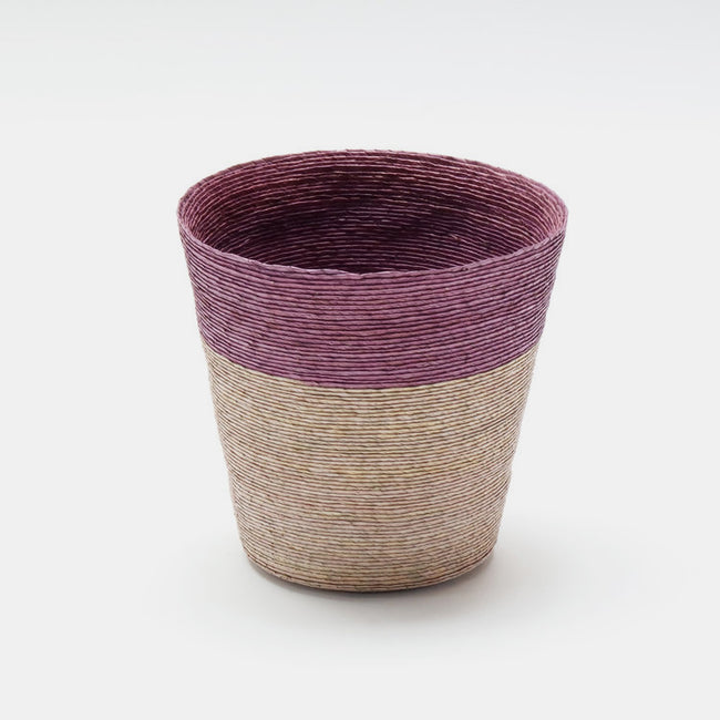 Short conical woven floor basket with purple upper and natural bottom perfect for a colorful new home decor and basket organization - Collyer's Mansion