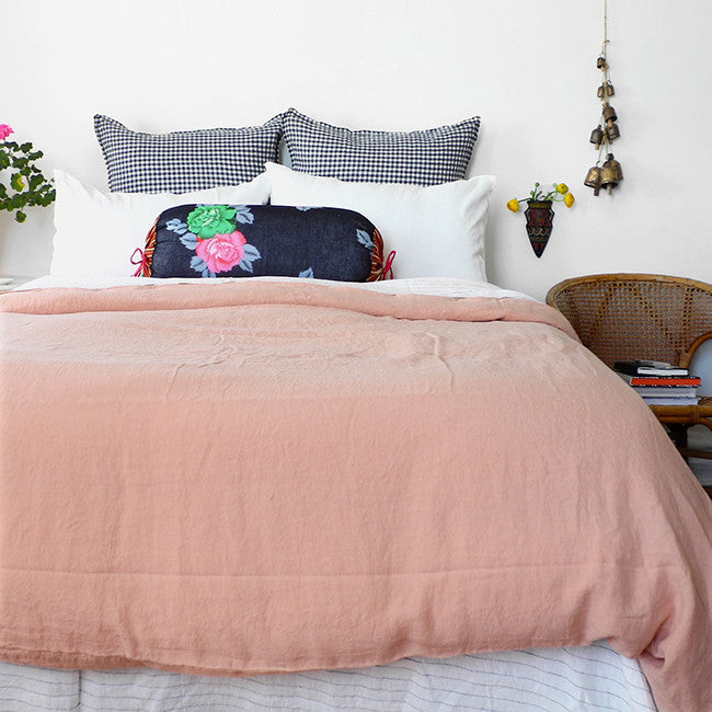 A Linge Particulier Linen Duvet in Copper gives a salmon and pink color to this duvet for a colorful linen bedding look from Collyer's Mansion