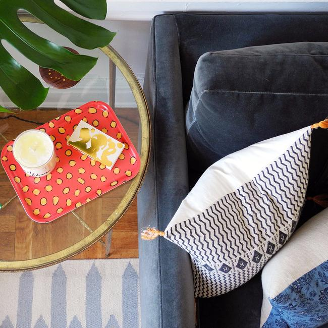 Rectangle designer tray in Scandinavian tray style in orange coral on side table with candle on it - Collyer's Mansion