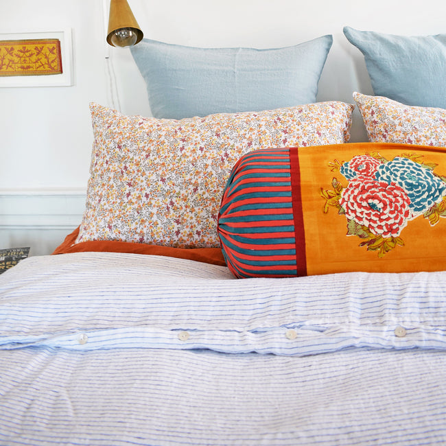 Linge Particulier Curry Flowers Standard Linen Pillowcase Sham with Lisa Corti pillow and blue stripe linen duvet for a colorful linen bedding look in yellow small floral pattern - Collyer's Mansion