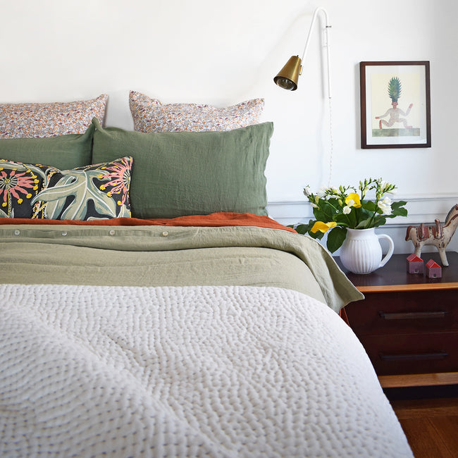 Linge Particulier Jade Green Standard Linen Pillowcase Sham with a stitched Indian quilt and green Utopia Goods pillow for a colorful linen bedding look in camo green - Collyer's Mansion