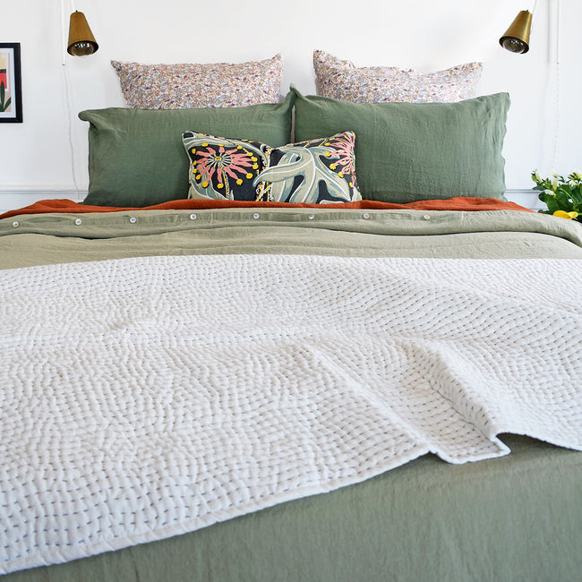 A Linge Particulier Linen Duvet in Fennel gives a olive and camo color to this duvet for a green colorful linen bedding look from Collyer's Mansion