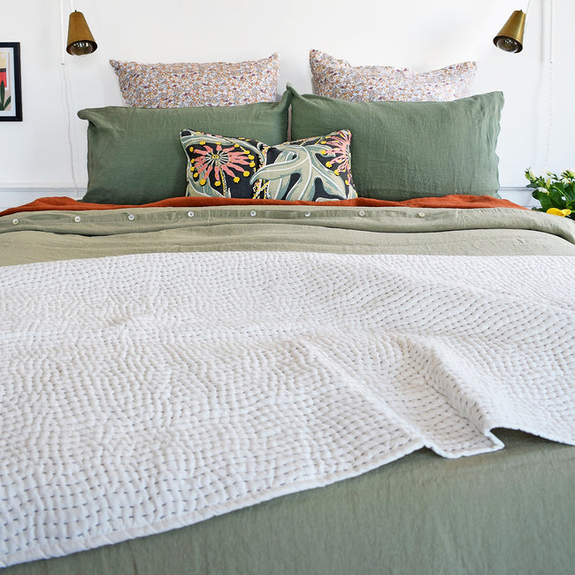 Linge Particulier Jade Green Standard Linen Pillowcase Sham with a fennel green linen duvet and green Utopia Goods pillow for a colorful linen bedding look in camo green - Collyer's Mansion