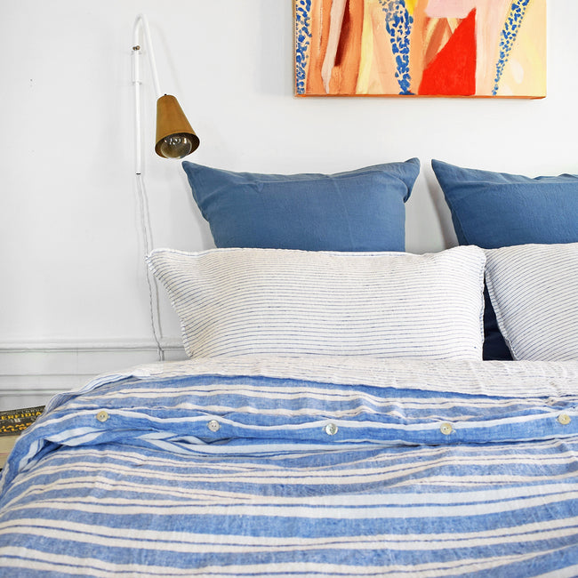 A Linge Particulier Linen Duvet in Large Blue Stripes gives a blue and white stripe color to this duvet for a colorful patterned and printed linen bedding look from Collyer's Mansion