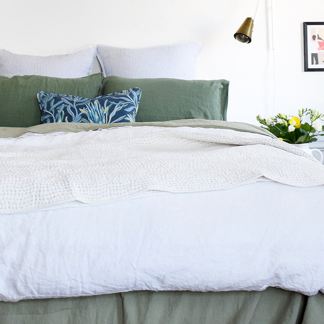 Linge Particulier Jade Green Standard Linen Pillowcase Sham with a white linen duvet and blue Utopia Goods pillow for a colorful linen bedding look in camo green - Collyer's Mansion