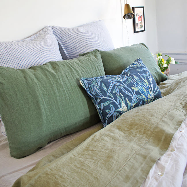 Linge Particulier Jade Green Standard Linen Pillowcase Sham with a fennel green linen sheet and blue Utopia Goods pillow for a colorful linen bedding look in camo green - Collyer's Mansion