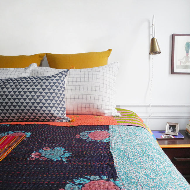 Linge Particulier Honey Yellow Euro Linen Pillowcase Sham with a Lisa Corti Gudri Kantha quilt for a colorful linen bedding look in mustard yellow - Collyer's Mansion