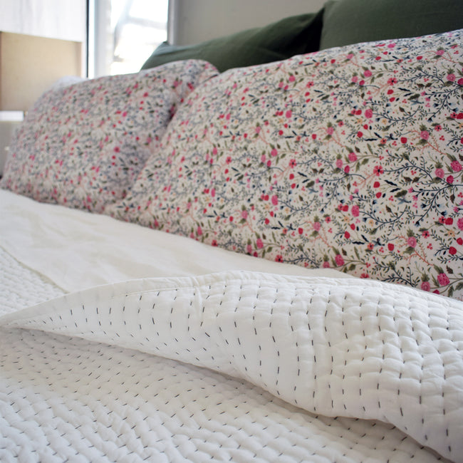 Linge Particulier Pink Flowers Standard Linen Pillowcase Sham with a stitched Indian quilt and jade euro shams for a colorful linen bedding look in small floral pattern - Collyer's Mansion