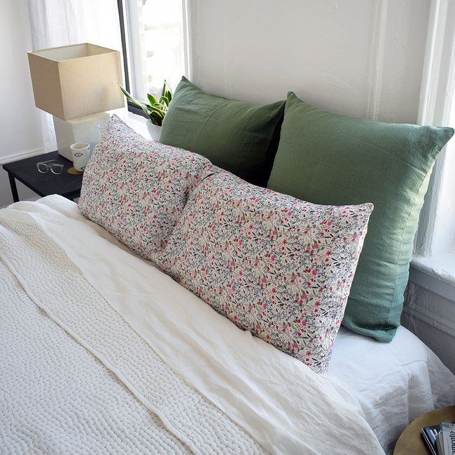 Linge Particulier Jade Green Euro Linen Pillowcase Sham with pink floral pillowcases and stitched Indian quilt for a colorful linen bedding look in camo green - Collyer's Mansion