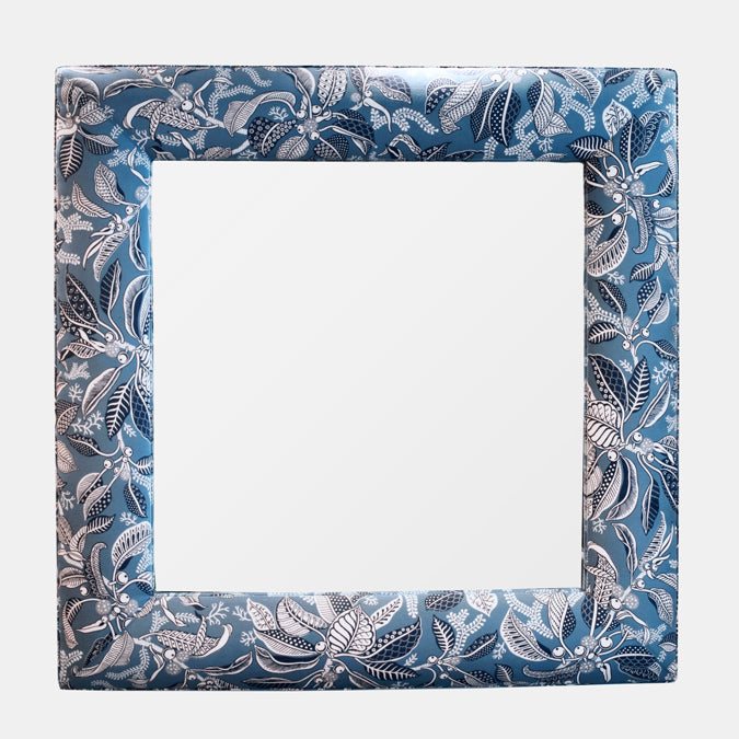 Upholstered statement mirror by Cisco at Collyer's Mansion