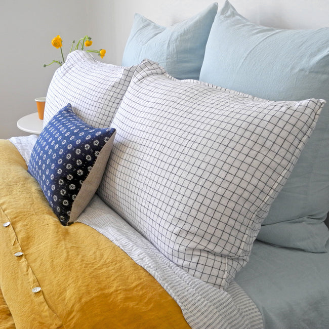 Linge Particulier Pale Blue Euro Linen Pillowcase Sham with a honey yellow linen duvet for a colorful linen bedding look in light blue - Collyer's Mansion