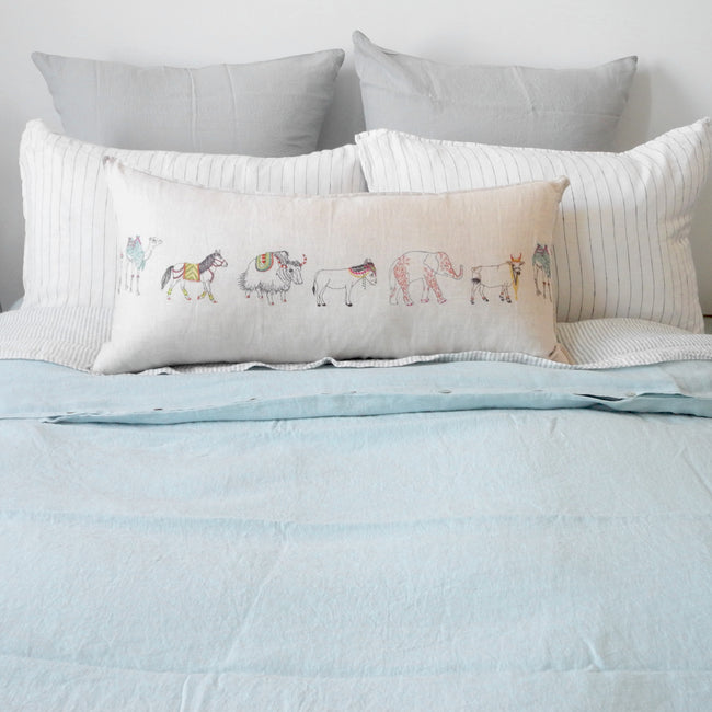 A Linge Particulier Linen Duvet in Pale Blue gives a light blue and robin's egg blue color to this duvet for a colorful linen bedding look from Collyer's Mansion