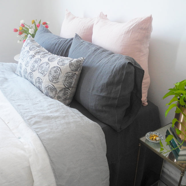 Linge Particulier Nude Euro Linen Pillowcase Sham with grey linen sheet and charcoal grey linen pillowcases with a Coral & Tusk pillow for a colorful linen bedding look in soft blush pink - Collyer's Mansion