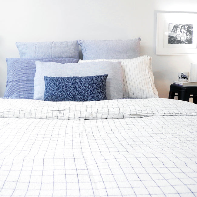 Linge Particulier Blue Thin Stripe Standard Linen Pillowcase Sham with navy check linen duvet and blue pillowcases for a colorful linen bedding look in small stripe pattern - Collyer's Mansion