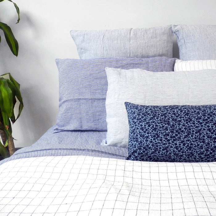 A Linge Particulier Linen Duvet in Navy Check gives a white and blue windowpane color to this duvet for a colorful patterned and printed linen bedding look from Collyer's Mansion