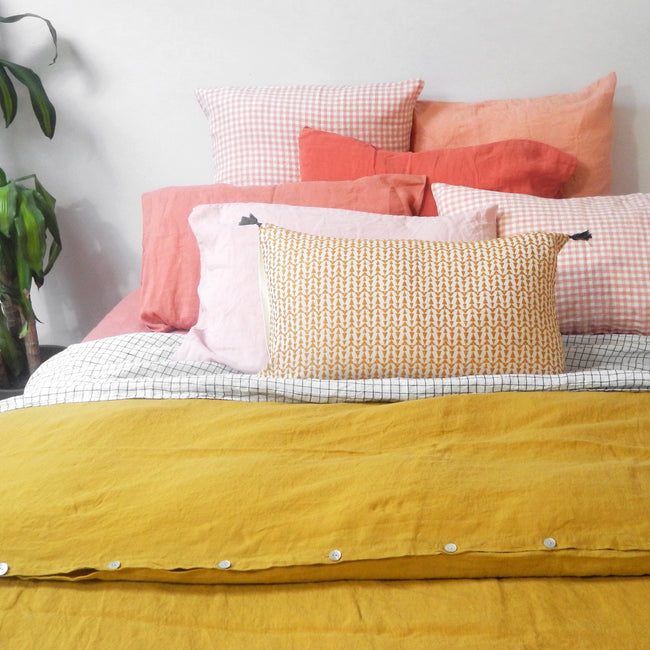 Linge Particulier Terracotta Pink Standard Linen Pillowcase Sham with a honey yellow linen duvet for a colorful linen bedding look in sunset orange - Collyer's Mansion