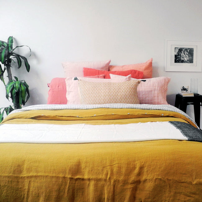 Linge Particulier Terracotta Pink Standard Linen Pillowcase Sham with honey yellow linen duvet for a colorful linen bedding look in sunset orange - Collyer's Mansion