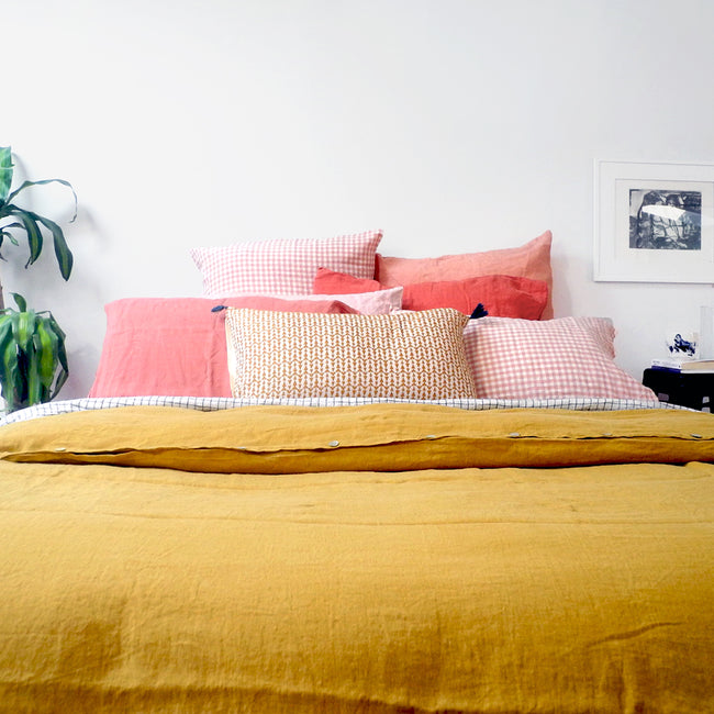 A Linge Particulier Linen Duvet in Honey gives a mustard and yellow color to this duvet for a colorful linen bedding look from Collyer's Mansion