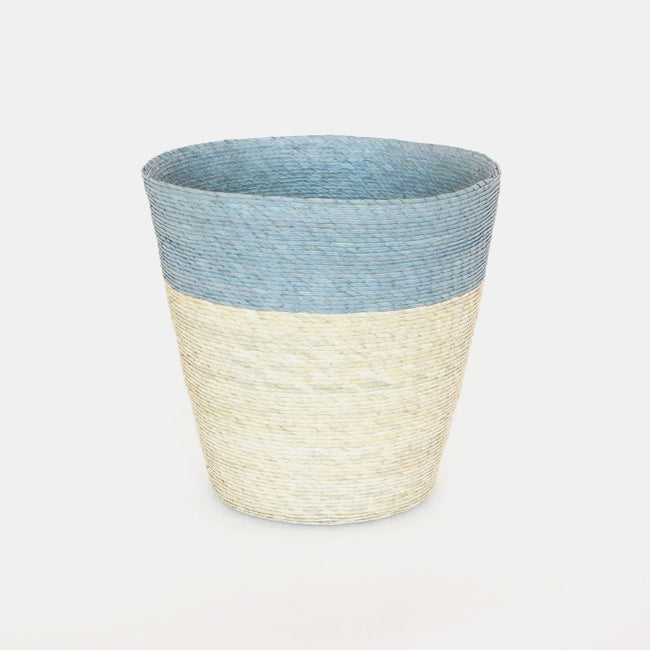 Short conical woven floor basket with blue upper and natural bottom perfect for a colorful new home decor and basket organization - Collyer's Mansion
