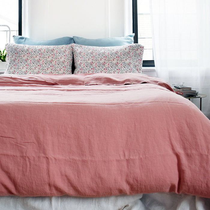 A Linge Particulier Linen Duvet in Lychee gives a deep salmon and old pink color to this duvet for a colorful linen bedding look from Collyer's Mansion