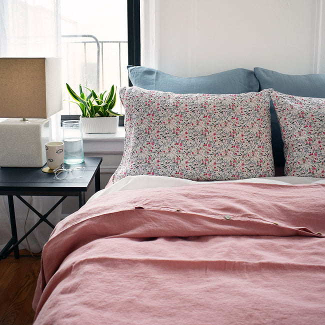 Linge Particulier Scandinavian Blue Euro Linen Pillowcase Sham with a pink linen duvet and small floral pattern linen pillowcases for a colorful linen bedding look in grey blue - Collyer's Mansion