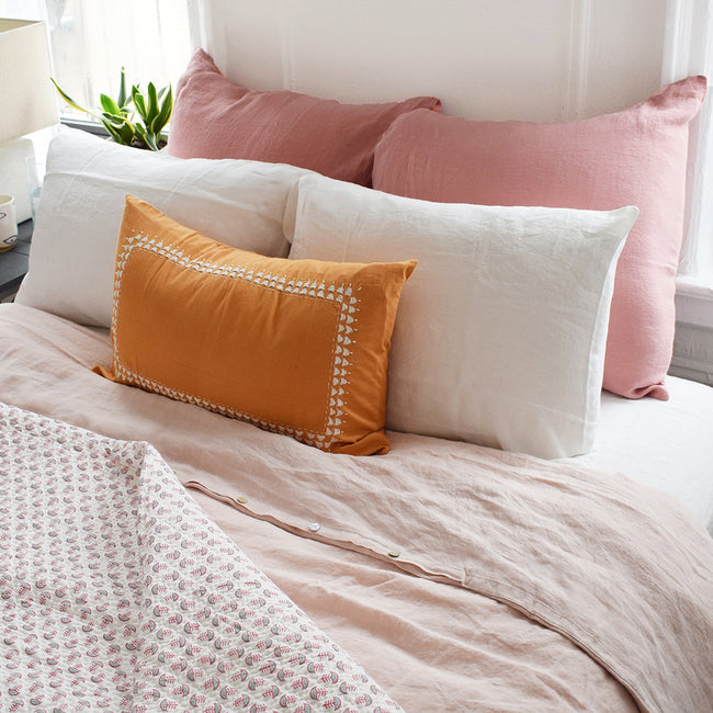 Go monochrome with this blush linen duvet and pink linen pillowcases