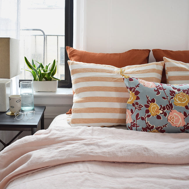 Linge Particulier Hazelnut Stripe Standard Linen Pillowcase Sham with a nude pink linen duvet and floral pillow for a colorful linen bedding look in earthy light orange - Collyer's Mansion