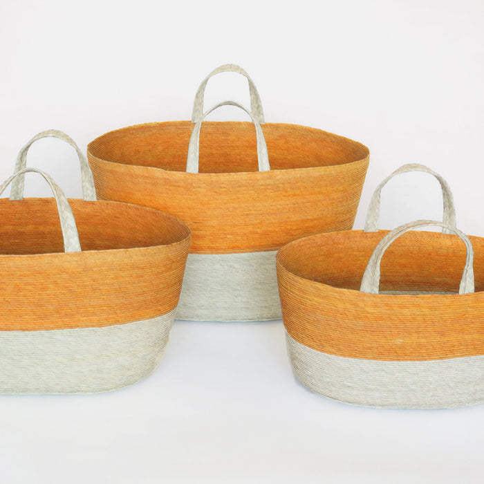 Oval handle floor basket in orange for colorful home decor and storage organization by Makaua at Collyer's Mansion