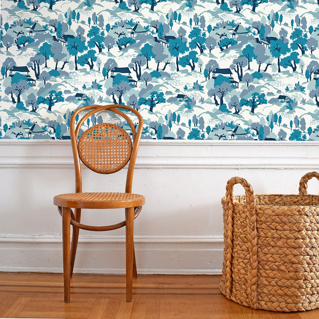 Blue and white landscape pagoda wallpaper in removable wallpaper and traditional wallpaper with navy houses and teal trees - Collyer's Mansion