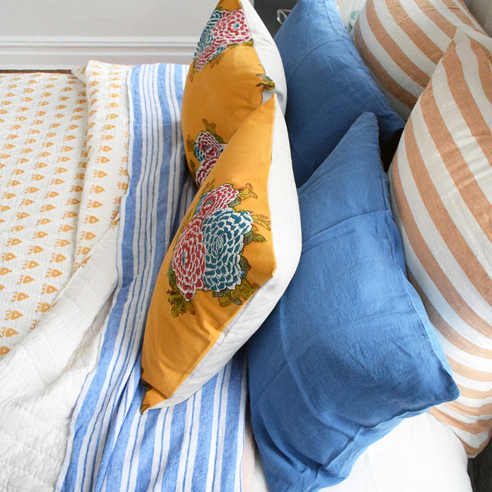 Block printed quilt in mustard yellow handmade by Serendipity Delhi for colorful bedding at Collyer's Mansion