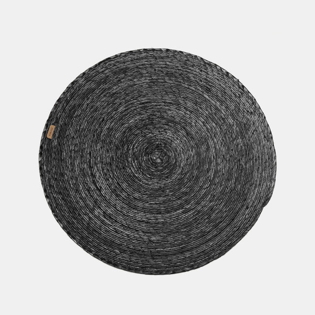 Black Round Woven Palm Placemat by Makaua at Collyer's Mansion
