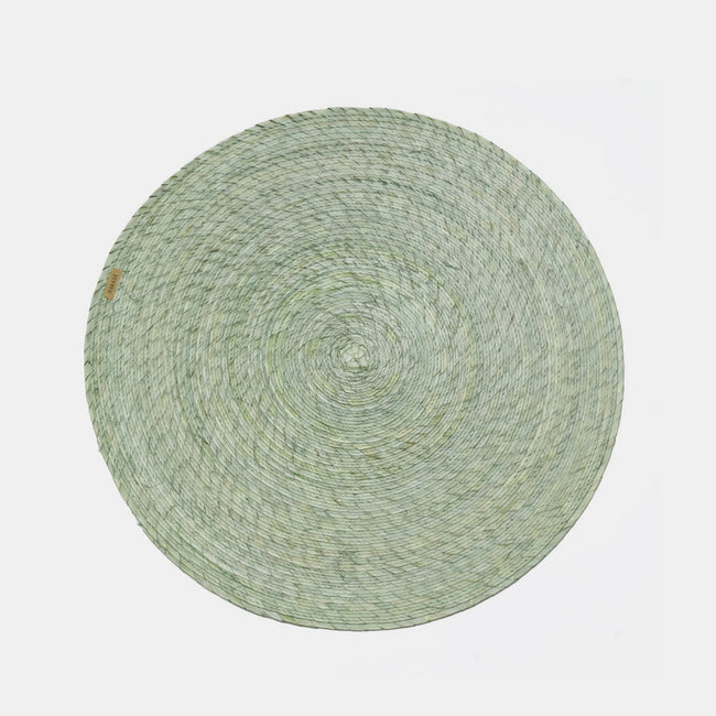 Green Round Woven Palm Placemat by Makaua at Collyer's Mansion