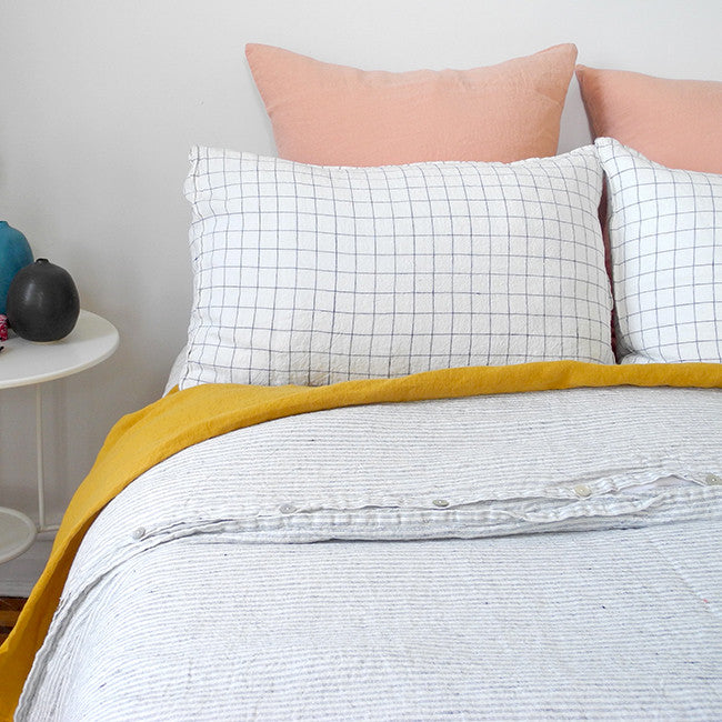 A Linge Particulier Linen Duvet in Pyjama Stripe gives a white and black ticking stripe color to this duvet for a neutral patterned and printed linen bedding look from Collyer's Mansion
