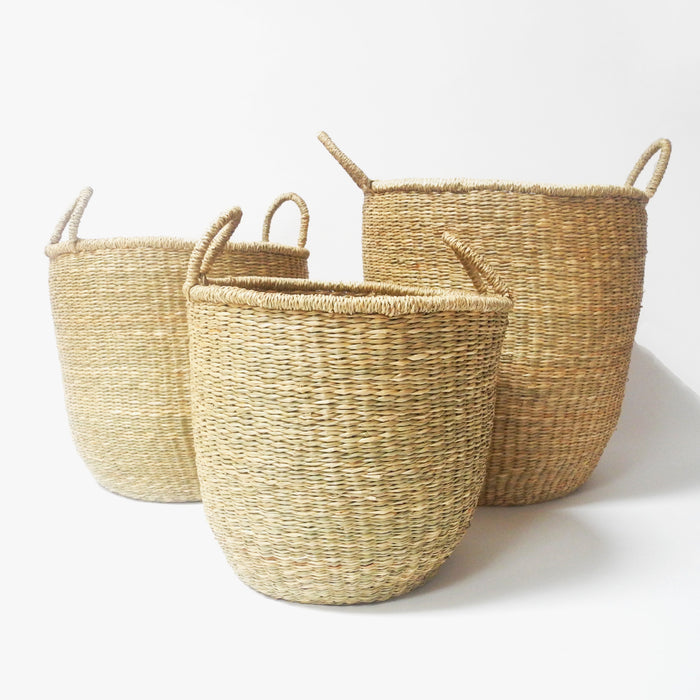 Tall woven floor basket in seagrass natural color with handles in three sizes for boho home decor - Collyer's Mansion