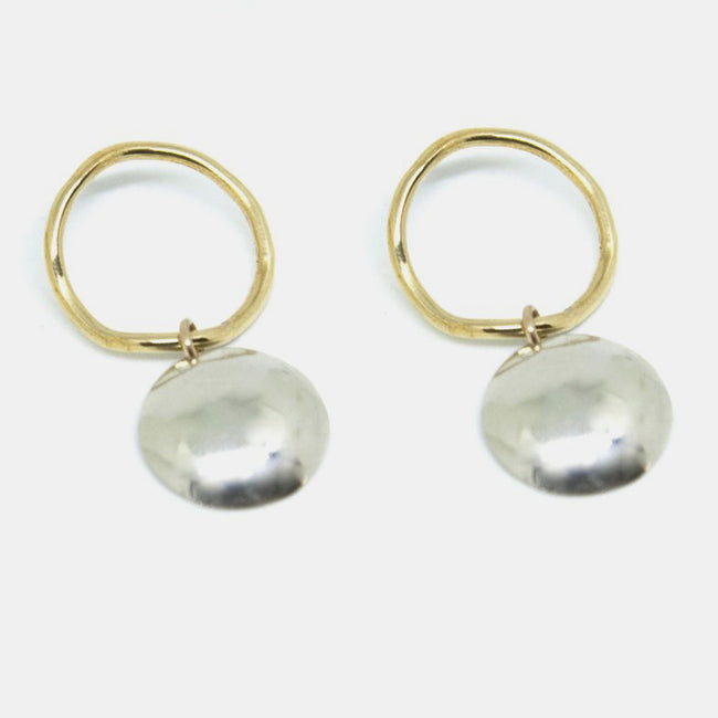 Slantt Petite Pilar Earrings are beautiful brass hoops with sterling silver domes and are the perfect statement earrings - Collyer's Mansion