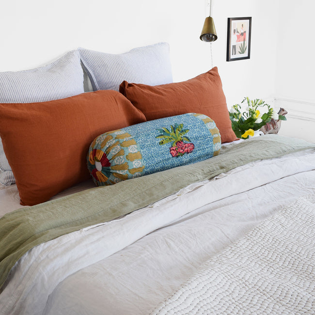 Linge Particulier Sienna Orange Standard Linen Pillowcase Sham with Lisa Corti bolster pillow and blue stripe euro shams for a colorful linen bedding look in burnt orange - Collyer's Mansion