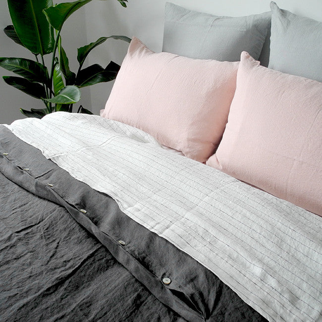 Linge Particulier Cloud Grey Euro Linen Pillowcase Sham with a charcoal linen duvet and nude pink pillowcases for a colorful linen bedding look in light grey - Collyer's Mansion