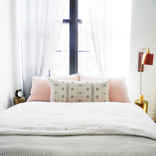 Linge Particulier Nude Standard Linen Pillowcase Sham with a Coral & Tusk pillow for a colorful linen bedding look in soft blush pink - Collyer's Mansion