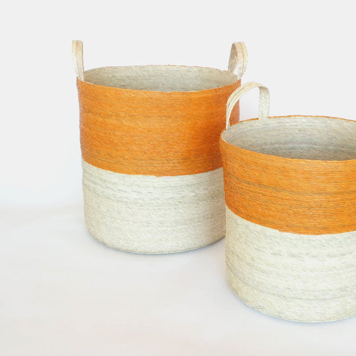 Tall handle woven floor basket with orange upper and natural bottom perfect for a colorful new home decor and basket organization - Collyer's Mansion.