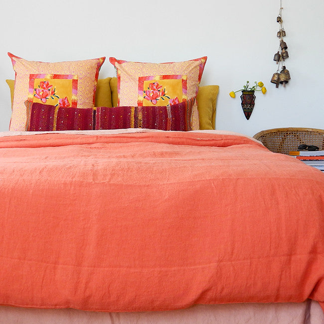 A Linge Particulier Linen Duvet in Terracotta gives a vibrant orange and sunset color to this duvet for a colorful linen bedding look from Collyer's Mansion