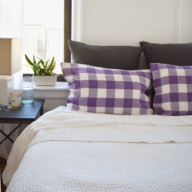 Linge Particulier Storm Grey Euro Linen Pillowcase Sham with a stitched Indian quilt and violet purple gingham pillowcases for a colorful linen bedding look in charcoal grey - Collyer's Mansion