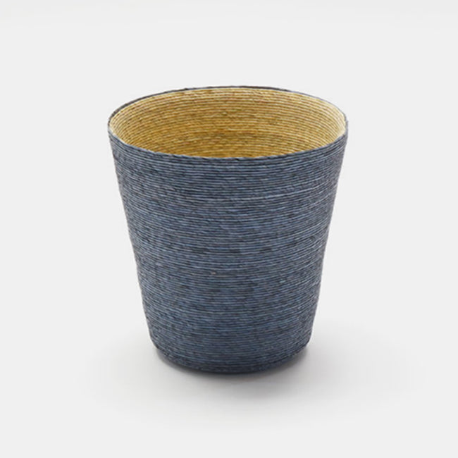Short conical woven floor basket with blue outside and natural inside perfect for a colorful new home decor and basket organization - Collyer's Mansion