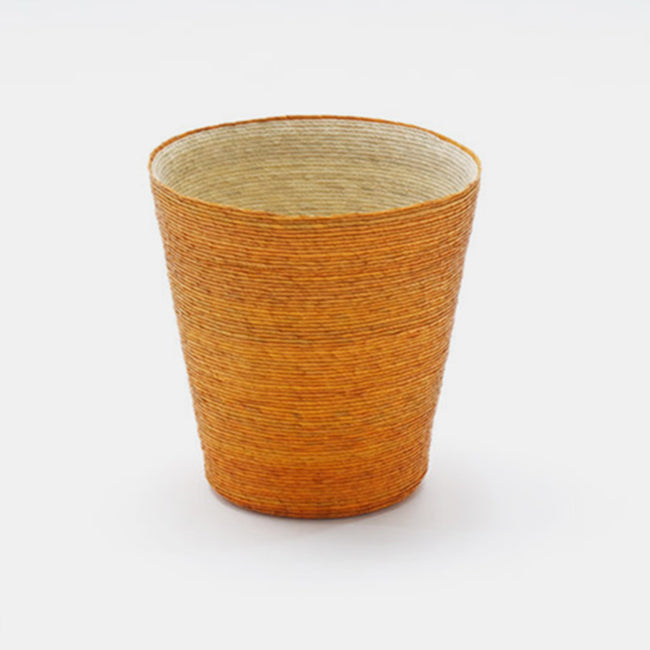Short conical woven floor basket with orange outside and natural inside perfect for a colorful new home decor and basket organization - Collyer's Mansion