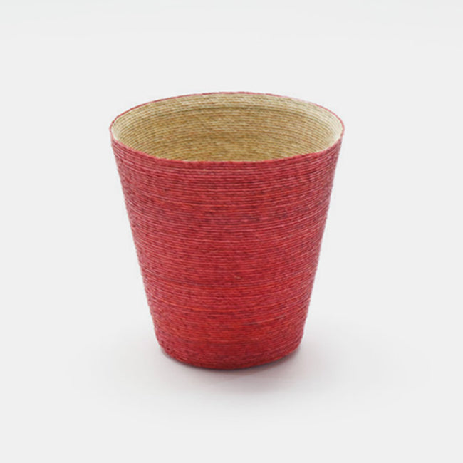 Short conical woven floor basket with red outside and natural inside perfect for a colorful new home decor and basket organization - Collyer's Mansion