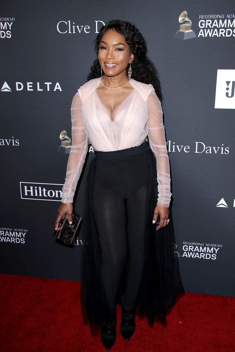 Angela Bassett carries 'Nam Hai' to the Clive Davis Pre Grammy Gala