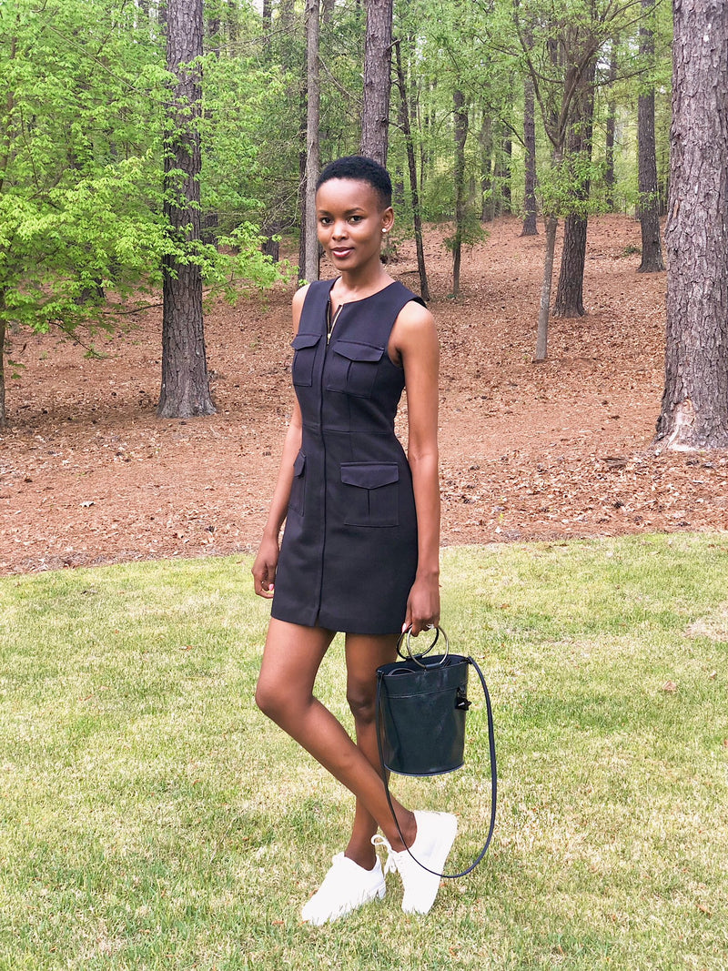 "FLAVIANA MATATA CARRIES ""MARIGOT BUCKET BAG"" TO THE 2018 GOLF MASTERS APRIL 7TH, 2018"
