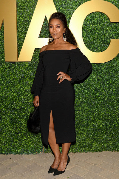 Angela Bassett carries the 'Majorelle' to the Macro Pre- Oscar Party