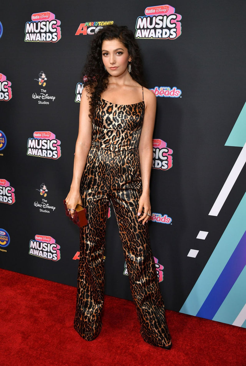 CAROLINE ROMANO CARRIES THE 'CIGGONES' BURGANDY MINK TO THE DISNEY MUSIC AWARDS - JUNE 25TH 2018